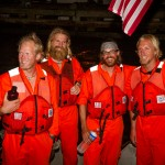 OAR Northwest approaches land on a USCG boat after a rescue mission where their ocean rowing boat capsized approximately 850 miles from their Miami destination on Saturday, April 6, 2013. Shown in photo: Adam Kreek, Jordan Hanssen, Patrick Fleming, Markus Pukonen (L to R)