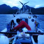Jordan preparing meal at dusk off McKay Island