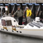 "Two people inspect the rebuilt ""James Robert Hanssen"" boat."