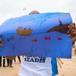 Homemade signs from a student at the International School of Dakar provided valuable send-off smile material (Credit: Canadian Wildlife Federation / Erinn J Hale Photography)